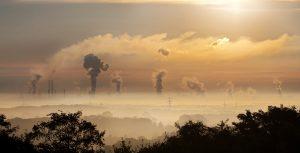 smoke stacks on the horizon